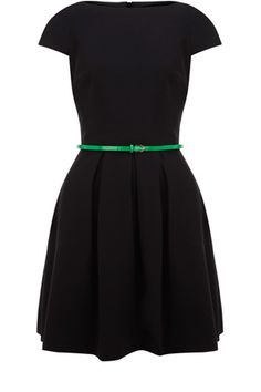 A classic shift dress, this piece has short capped sleeves, a nipped in waist with a belt, provided, and flared skirt that finishes above the knee. Fabulous 50s in style, the piece zips up the back and is smart enough for the office but stylish enough for play.