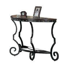 Poundex Firebird Series Console Table Round Glass And Rod Iron Finish by Poundex, http://www.amazon.com/dp/B008362YWA/ref=cm_sw_r_pi_dp_eXDcrb07K6A80