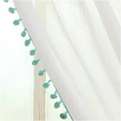 poms on white curtains