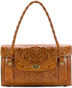 From the Burnished Tooled Collection by Patricia Nash&& the Sanabria Satchel Bag features& closurelined interiorfooted bottomslip pocket insideslip pocket under flapdouble handlesapprox& x x handle dropImported& Tooled Leather Purse, Leather Tooling, Leather Satchel, Leather Purses, Satchel Bag, Leather Carving, Leather Bags Handmade, Leather Craft, Patricia Nash