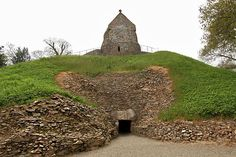 12th century Lady of the Dawn Christian Chapel is superimposed on La Hogue Bie Dolmen, an ancient pagan tomb on the British Isle of Jersey