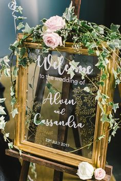 Alvin and Cassandra's Wedding Luncheon at Cantaloupe - Lovely pink roses and ample greenery sprawled over a gold-framed wedding sign with white calligraph - Gold Wedding Colors, Pink And Gold Wedding, Spring Wedding Colors, Gold Wedding Decorations, Blush Pink Weddings, Wedding Cakes With Flowers, Spring Weddings, Flower Cakes, Wedding Cupcakes