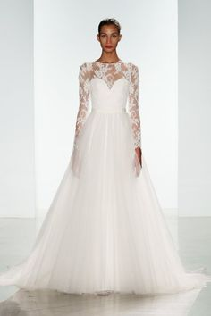 Ivory wedding dress from Nouvelle Amsale with Grograin tulle over skirt.