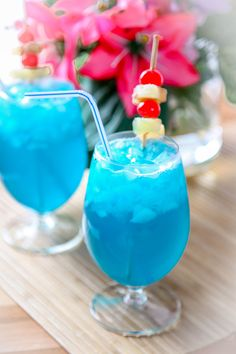 Blue Hawaiian Recipe - 1 Oz. Coconut Rum 1 Oz. Blue Curacao 2 Oz. Pineapple Juice 1 C. Crushed Ice