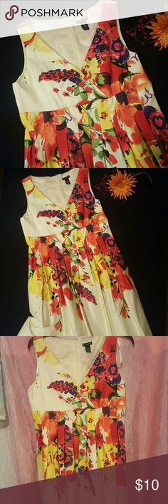 Beautiful Pleated Dress This is been worn to one event ,like new. New Directions size 12P. This is yellow back color with multi colored floral design. Deep v neck and pleated waist line.  This is cotton and spandex so stretch a little. Zips up back.  Smoke free home new directions Dresses Midi