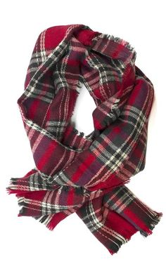 This Miller Plaid scarf makes the perfect accessory during the Holiday season.