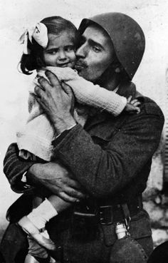 1940 ~ A Greek soldier says goodbye to his young daughter before being mobilized to the front to counter against Axis Italian and German invasion