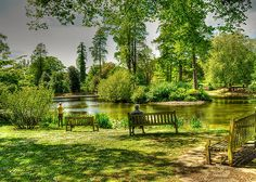 I just wanna sit on that park bench and take it all in. Sackler Lake Kew Gardens. The quintessential English scene of a couple enjoying the stunning gardens of the Royal Horticultural Society Richmond London.  Summer Time by John Hare at redbubble.com.