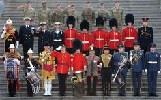 Military personnel pose at Wellington Barracks in their ceremonial uniforms, which they will wear when taking part in the Queen's Diamond Jubilee celebrations in June