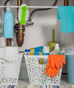 If you're lucky enough to have closed storage under your bathroom sink, use it for stashing cleaning supplies and extra toilet paper. Give the things you use daily a prominent spot, and store everything else together.