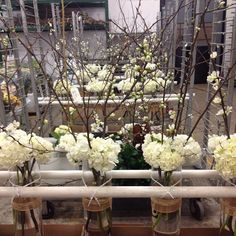 Our talented designers have been busy working on these beautiful arrangements for a wedding! #Flowers #Wedding #WeddingFlowers #Blooms #Hydrangea #Branches #Indy