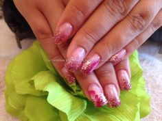Full acrylic with pink glitter fade and one stroke nail art