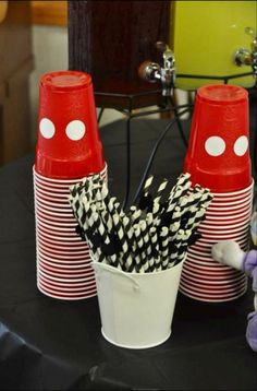 Punch up the cups.  See more Mickey Mouse birthday ideas and birthday parties for kids at www.one-stop-party-ideas.com