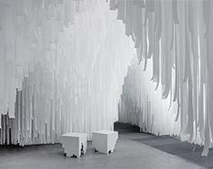 COS x snarkitecture turn milan's spazio erbe into a cavernous fabric retreat