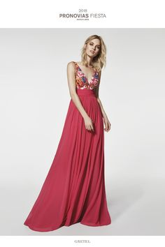 Marvellous flared cocktail dress fitted at the waist made of gauze. A V-neckline and beautiful back in multicolour tulle contrast to perfection with a light flowing skirt, creating a very feminine and elegant silhouette.