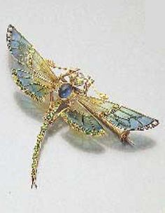 An Art Nouveau dragonfly brooch, by Gompers Paris, 1900. Mounted in 18k gold, with openwork wings decorated with plique-à-jour enamel in shades of golden yellow and blue, the body set with a cabochon sapphire, the eyes, tail and wings highlighted with demantoid garnets, the head set with diamonds. With maker's mark.