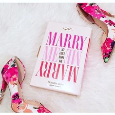 """kate spade """"Marry Me"""" Clutch NWT! We love book clutches - sometimes their titles tell the stories of our lives; or remind us of our favorite time. For brides-to-be and romantics alike, the title for our latest novel clutch - was inspired by a feeling of love in the air. (*Due to PVC nature, shows few scratches. Only carried for Engagement photos*) - Handheld frame in printed cotton twill under clear pvc. - The lined interior has a dividing zip pocket and 3 card slots. - Dimensions: 5.9''h x…"""