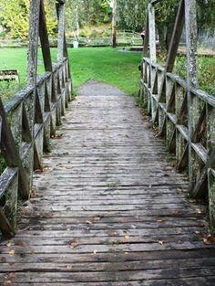 wooden bridge over trail