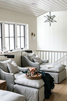 Ticking stripe pillows accent gray chaise lounges displaying black floor reading lamps in a upstairs cottage family room used as a movie room. Living Room Colors, Rugs In Living Room, Living Room Decor, Curtains Living, Room Rugs, Dining Rooms, Grey Chaise Lounge, Lounge Chairs, Club Chairs