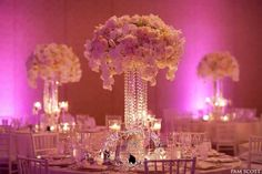 Vases draped with strands of crystals and tied with antique brooches brought sparkle to the Four Seasons Resort Maui ballroom.