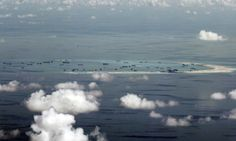 FILE - This May 11, 2015, file photo, shows land reclamation of Mischief Reef in the Spratly Islands in the South China Sea.  A landmark ruling on an arbitration case filed by the Philippines that seeks to strike down China's expansive territorial claims in the South China Sea will be a test for international law and world powers. China, which demands one-on-one talks to resolve the disputes, has boycotted the case and vowed to ignore the verdict, which will be handed down Tuesday, July 12…