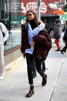 Lovely layers: Keeping the cold at bay and looking cool doing it, with a burgundy bomber jacket which she wore hanging off one shoulder