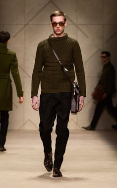 Olive Aran knit sweater and leather satchel on the runway of the Burberry A/W13 Menswear show