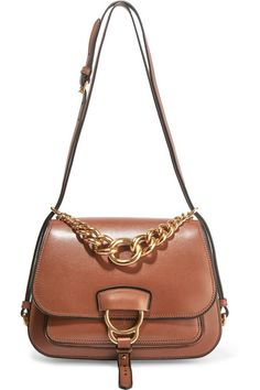 Tan leather (Calf) Snap-fastening front flap Designer color: Brandy Comes with…