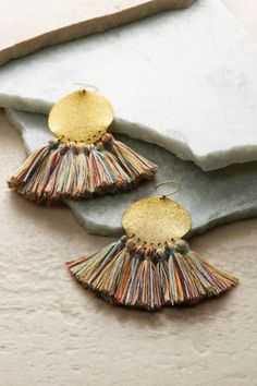 Coachella-ready earrings deliver the boho experience with textured brass discs and a contrasting fringe of multicolored cotton tassels. You'll love their playful attitude and handcrafted appeal. Festival Fringe Earrings #1AT39