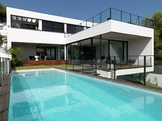 Swimming Pool  White Residence in Spain Incorporating Modern Volumes by LADAA Studio