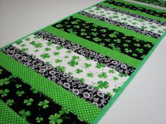 Quilted Table Runner , St. Patrick's Day Table Runner , Shamrocks , Scrappy Strips , Green/Black/White by VillageQuilts on Etsy