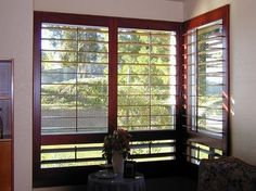 """Louvered 5 ½"""" solid mahogany shutters in parlor in El Cajon, CA. www.sandiego-shutters.com"""