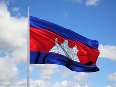 The flag of Cambodia consists of three horizontal stripes in blue-red-blue combination. While the blue color denotes the nation's royalty, the red represents the nation. A three-towered temple at the center signifies Angkor Wat, the world's largest religious monument that is located in the country. Adopted following Cambodia's independence in 1948 until 1970, it was re-introduced in 1993.