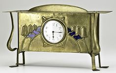 """ENGLISH ARTS & CRAFTS;  Mantle clock, ca. 1900; Brass-washed copper, enamel, glass; Unmarked; 10"""" x 16 1/4"""" x 4 1/2""""  