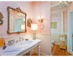 Celebrity Bathroom: Kirstie Alley (Islesboro Beach, Maine)... Love the mirror and pictures next to it. Makes me want to put portraits of a man and woman there