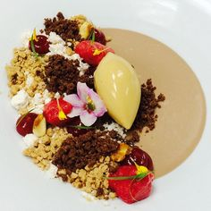Chocolate Custard, Salted caramel Ice Cream , peanut butter snow , frozen. Chocolate sand, peanuts streusel, Raspberry