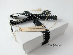 This gorgeous double bar necklace features two skinny long bars which can be left plain or personalized with names, initials, a special date or phrase, so that your bar necklace reflects you and what is important to you.  It looks great worn on it's own or layered with other delicate gold necklaces from The Gold Bar. Double Bar Necklace Personalized Gold Bar Necklace by TheGoldBar