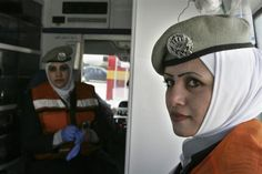 Jordanian women from the civil defence department take part in a routine intervention to provide first aid to citizens in Zarqa city, 25 km (16 miles) east of Amman January 27, 2010. Since 2007, the Jordanian civil defence started working to integrate the female component of its work within the official crew. So far, 81 women have graduated in first aid from the Faculty of Civil Defence. REUTERS-Muhammad Hamed