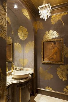 Gold Gingko Powder Bath - This Woodlands, TX powder room is elegantly finished with chocolate pearl fresco on the walls with all over gold foil gingko leaf design, gold foil ceiling and trim as well as gold wax detailing on the vanity. Bad Inspiration, Bathroom Inspiration, Bathroom Ideas, Wc Decoration, Leaf Stencil, Stencil Decor, Wall Stencil Patterns, Bathroom Wallpaper, Painted Wallpaper