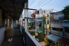 Vietnam's Vegan House is covered from top to bottom in vibrantly painted shutters.