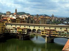 The Ponte Vecchio (Old Bridge) is a medieval bridge spanning the river Arno in Florence. It is one of the few remaining bridges with houses built upon. The Vasari corridor that runs over the houses connects the Uffizi with the Pitti Palace on the other side of the river.