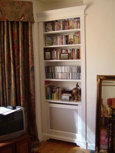 Concealed radiator cabinet and bookcase.