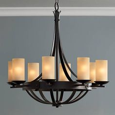 Rustic chic at its best, this bronze finish chandelier features gorgeous scavo glass and an elegant profile.