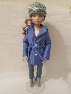 a trench coat for Ellowyne Wilde. The pattern is from a neat book from Doll Reader that has just patterns for Ellowyne; you can find it online at http://shop.dollsmagazine.com/books/doll-reader-pattern-book-featuring-ellowyne-wilde.html.