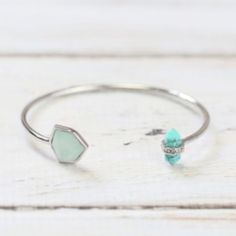 Statement Cuff This cool blue cuff adds an instant splash of style to any look. Geometric semi-precious turquoise and Opal with a modern silhouette. Hypoallergenic, nickel and lead free. Ocean Jewelers Jewelry