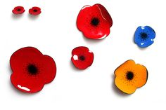 Beautiful enamelled poppy brooches.