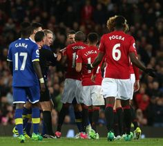 Ashley Young of Manchester United clashes with Kevin Mirallas of Everton during the Premier League match between Manchester United and Everton at Old...
