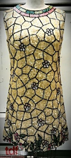 "This dress could be an antique. It is based on the design of a Tiffany's Lamp that all our ""old rich grandmothers"" have in their sitting rooms. Some trendy lady from the 60s had it made so she would stand out from all the rest and ended up donating it in her older age.  #TDFCC #1960s #KeepingUpWithTheCostumes"