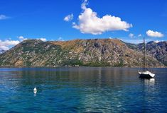 Photo about Photo of Kotor bay with cristal water a boat and a blue sky - Kotor Bay - Montenegro - July 2010. Image of kotor, blue, montenegro - 113952018