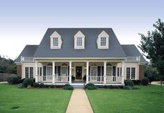 The Southern charm of the exterior this home is achieved by  its beautiful front porch featuring Fypon columns, shutters and decorative window accents.  http://www.thehousedesigners.com/plan/banner-hall-3000-3601/